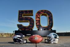 General view of Carolina Panthers and Denver Broncos helmets with NFL Wilson Duke football at Super Bowl 50 sculpture at Twin Peaks. Kirby Lee-USA TODAY Sports