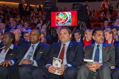 Dec 6, 2014; Gatineau, Victor Montagliani (centre) attend the official draw for the FIFA Women's World Cup Canada 2015 at The Canadian Museum of History. Marc DesRosiers-USA TODAY Sports
