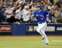 Oct 21, 2015; Toronto, Ontario, CAN;  Toronto Blue Jays third baseman Josh Donaldson (20) scores during the sixth inning against the Kansas City Royals in game five of the ALCS at Rogers Centre. Mandatory Credit: John E. Sokolowski-USA TODAY Sports