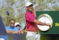 Charl Schwartzel of South Africa looks at the ball after the tee off at the second hole during DP World Tour Championship in Dubai November 21, 2015. REUTERS/Martin Dokoupil