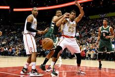 Feb 20, 2016; Atlanta, GA, USA; Atlanta Hawks forward Thabo Sefolosha (25) loses the ball to the defense of Milwaukee Bucks forward Jabari Parker (12) during the second half at Philips Arena. The Bucks defeated the Hawks 117-109 in double overtime. Mandatory Credit: Dale Zanine-USA TODAY Sports