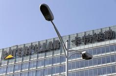 The company logo is seen on top of a building, where Caterpillar (China) Investment Co., Ltd. is located, behind a street lamp, in Beijing, in this file photo dated January 22, 2013. REUTERS/Jason Lee