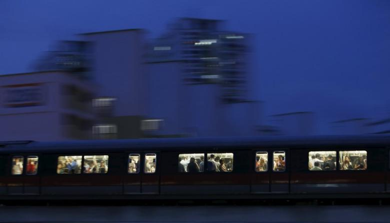 Commuters riding the train after office hours past a public housing estate in Singapore in this May 5, 2014 file photo. REUTERS/Edgar Su/Files