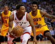 Feb 26, 2016; Toronto, Ontario, CAN; Toronto Raptors guard Kyle Lowry (7) looks to pass the ball as Cleveland Cavaliers guard Iman Shumpert (4) defends at the Air Canada Centre. Mandatory Credit: John E. Sokolowski-USA TODAY Sports