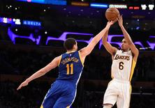 Mar 6, 2016; Los Angeles, CA, USA; Los Angeles Lakers guard Jordan Clarkson (6) shoots over Golden State Warriors guard Klay Thompson (11) during the NBA game at the Staples Center. Mandatory Credit: Richard Mackson-USA TODAY Sports