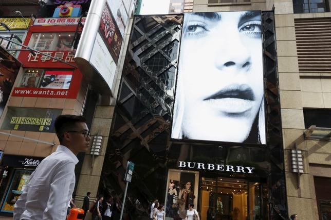 A model is seen on the screen of a Burberry store at Causeway Bay shopping district in Hong Kong, China, July 16, 2015.  REUTERS/Bobby Yip
