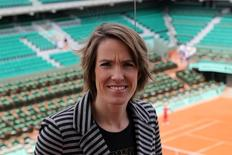 Former Belgian tennis player Justine Henin poses on top roof of the Philippe Chartrier court as she attends as TV consultant the quarter-final matches at the French Open tennis tournament at the Roland Garros stadium in Paris June 5, 2012.   REUTERS/Francois Lenoir
