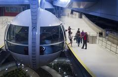 Passengers leave the cabin after riding the 550 foot-tall (167.6 m) High Roller observation wheel, the tallest in the world, in Las Vegas, Nevada April 9, 2014.  REUTERS/Las Vegas Sun/Steve Marcus