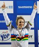 Australia's Caroline Buchanan celebrates her victory after the women's four cross at the UCI Mountain Bike World Championships in Mount Ste-Anne, Beaupre, September 3, 2010. REUTERS/Mathieu Belanger