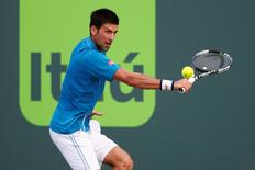 Mar 27, 2016; Key Biscayne, FL, USA; Novak Djokovic hits a backhand against Joao Sousa (not pictured) during day six of the Miami Open at Crandon Park Tennis Center. Geoff Burke-USA TODAY Sports