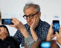 Journalists take pictures with their mobile phones as director Woody Allen attends a news conference during the 68th Cannes Film Festival in Cannes, southern France, in this May 15, 2015 file photo. REUTERS/Regis Duvignau/Files