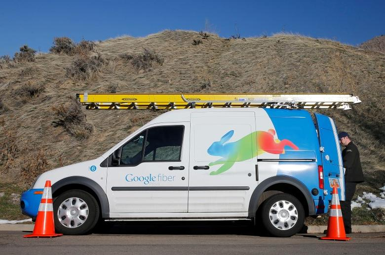 A Google Fiber technician gets supplies out of his truck to install Google Fiber in a residential home in Provo, Utah, January 2, 2014.  REUTERS/George Frey