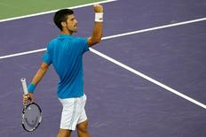 Mar 29, 2016; Key Biscayne, FL, USA; Novak Djokovic celebrates after match point against Dominic Thiem (not pictured) during day nine of the Miami Open at Crandon Park Tennis Center. Mandatory Credit: Geoff Burke-USA TODAY Sports