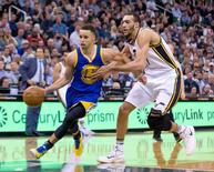 Mar 30, 2016; Salt Lake City, UT, USA; Golden State Warriors guard Stephen Curry (30) dribbles the ball in front of Utah Jazz center Rudy Gobert (27) during the second half at Vivint Smart Home Arena. Russ Isabella-USA TODAY Sports