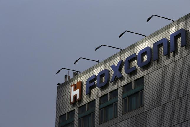 The logo of Foxconn, the trading name of Hon Hai Precision Industry, is seen on top of the company's headquarters in New Taipei City, Taiwan March 29, 2016. REUTERS/Tyrone Siu