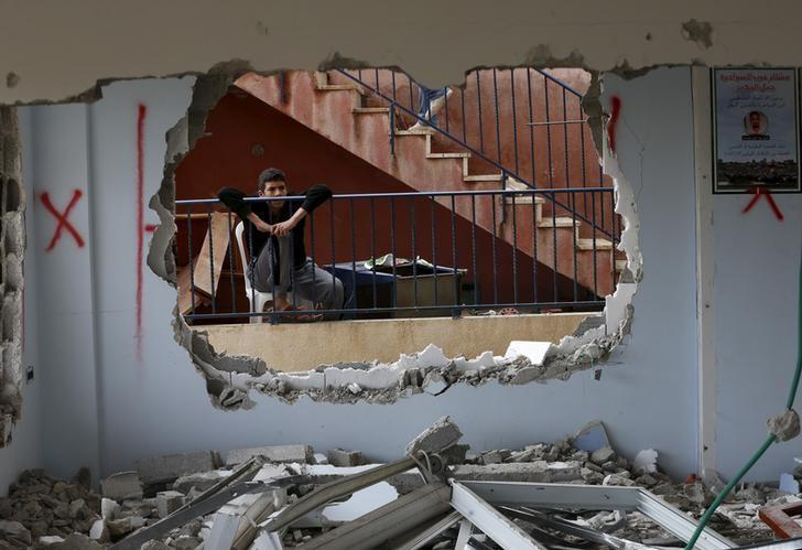 A relative looks at the demolished house of Palestinian Bahaa Mohammed Halil Allyan in the Arab east Jerusalem neighbourhood of Jabel Mukaber January 4, 2016. REUTERS/Ammar Awad
