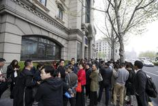 Investors gather at the office of Shanghai investment firm Zhongjin Capital Management in Shanghai, China, April 7, 2016. REUTERS/Aly Song
