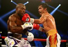 April 9, 2016; Las Vegas, NV, USA; Manny Pacquiao lands a punch to bring down Timothy Bradley at MGM Grand Garden Arena. Mandatory Credit: Mark J. Rebilas-USA TODAY Sports