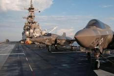 F-35 Bravo Lightning II stand ready on the deck of amphibious assault ship USS Wasp for day two of the first phase operational testing in the Atlantic Ocean in this handout photo taken May 19, 2015 and provided by the U.S. Navy. REUTERS/U.S. Navy/Chief Mass Communication Specialist Willam Tonacchio/Handout via Reuters