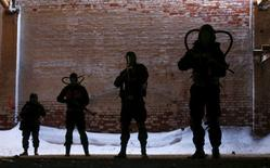 """German, """"Irbis"""", 29, Mikhail, """"Molokh"""", 30, Dmitry, """"Mirt"""", 25, and Viktor, """"Kar"""", 20 (L-R)  dressed in stalker costumes which identify the group """"Dolg"""", pose for a portrait in Moscow, Russia, March 27, 2016. REUTERS/Maxim Shemetov"""