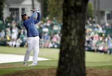 Apr 10, 2016; Augusta, GA, USA; Louis Oosthuizen hits a shot from the rough on the 1st hole during the final round of the 2016 The Masters golf tournament at Augusta National Golf Club. Mandatory Credit: Rob Schumacher-USA TODAY Sports