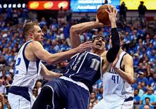 Apr 23, 2016; Dallas, TX, USA; Oklahoma City Thunder center Enes Kanter (11) scores past Dallas Mavericks forward David Lee (42) and forward Dirk Nowitzki (41) during the fourth quarter in game four of the first round of the NBA Playoffs at American Airlines Center. Mandatory Credit: Kevin Jairaj-USA TODAY Sports
