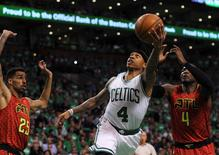 Apr 24, 2016; Boston, MA, USA; Boston Celtics guard Isaiah Thomas (4) lays the ball in the basket past Atlanta Hawks forward Thabo Sefolosha (25) and forward Paul Millsap (4) during the first half in game four of the first round of the NBA Playoffs at TD Garden. Bob DeChiara-USA TODAY Sports