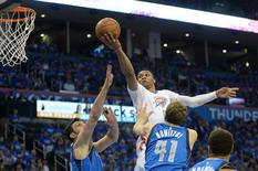 Apr 25, 2016; Oklahoma City, OK, USA; Oklahoma City Thunder guard Russell Westbrook (0) shoots the ball over Dallas Mavericks forward Dirk Nowitzki (41) and center Zaza Pachulia (27) during the third quarter in game five of the first round of the NBA Playoffs at Chesapeake Energy Arena. Mandatory Credit: Mark D. Smith-USA TODAY Sports