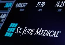 The ticker and trading information for St. Jude Medical is displayed where the stock is traded on the floor of the New York Stock Exchange (NYSE) in New York City, U.S., April 28, 2016.  REUTERS/Brendan McDermid