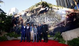 """Director of the movie Jon Favreau (R) poses with cast members (L-R) Ritesh Rajan, Giancarlo Esposito, Lupita Nyong'o, Neel Sethi and Ben Kingsley at the premiere of """"The Jungle Book"""" at El Capitan theatre in Hollywood, California April 4, 2016. REUTERS/Mario Anzuoni"""