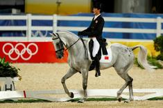 Alex Hua Tian from China rides Chico during the equestrian eventing dressage competition at the Beijing Olympic Games 2008 in Hong Kong August 9, 2008.   REUTERS/Bobby Yip  (CHINA)
