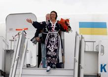 Crimean Tatar singer Susana Jamaladinova, known as Jamala, who won the Eurovision Song Contest, leaves a plane during a welcoming ceremony upon her arrival at Boryspil International Airport outside Kiev, Ukraine, May 15, 2016. REUTERS/Roman Baluk