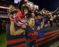 Sep 14, 2015; Santa Clara, CA, USA; San Francisco 49ers running back Jarryd Hayne (38) poses with an Australian flag after the game against the Minnesota Vikings at Levi's Stadium. Mandatory Credit: Kirby Lee-USA TODAY Sports