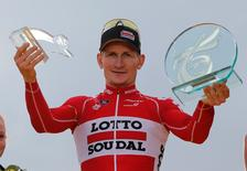 Lotto-Soudal rider Andre Greipel of Germany celebrates on the podium after winning the 109.5-km (68 miles) final 21st stage of the 102nd Tour de France cycling race from Sevres to Paris Champs-Elysees, France, July 26, 2015 in this file picture. REUTERS/Stephane Mahe