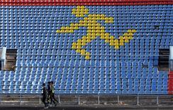 Sportsmen train at a local stadium in the southern city of Stavropol, Russia, November 10, 2015. REUTERS/Eduard Korniyenko/Files
