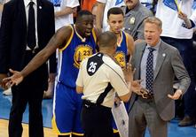 May 22, 2016; Oklahoma City, OK, USA; Golden State Warriors forward Draymond Green (23) and guard Stephen Curry (middle) and head coach Steve Kerr (right) argue with official Tony Brothers (25) during the first half against the Oklahoma City Thunder in game three of the Western conference finals of the NBA Playoffs at Chesapeake Energy Arena. Mandatory Credit: Mark D. Smith-USA TODAY Sports