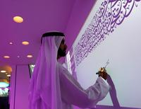 Sheikh Mohammed bin Rashid Al Maktoum, Vice-President and Prime Minister of the UAE and Ruler of Dubai, signs on the board during the official opening of the world's first functional 3D printed offices in Dubai May 23, 2016. REUTERS/Ahmed Jadallah