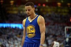 May 24, 2016; Oklahoma City, OK, USA; Golden State Warriors guard Stephen Curry (30) reacts after a play against the Oklahoma City Thunder during the third quarter in game four of the Western conference finals of the NBA Playoffs at Chesapeake Energy Arena. Mandatory Credit: Mark D. Smith-USA TODAY Sports