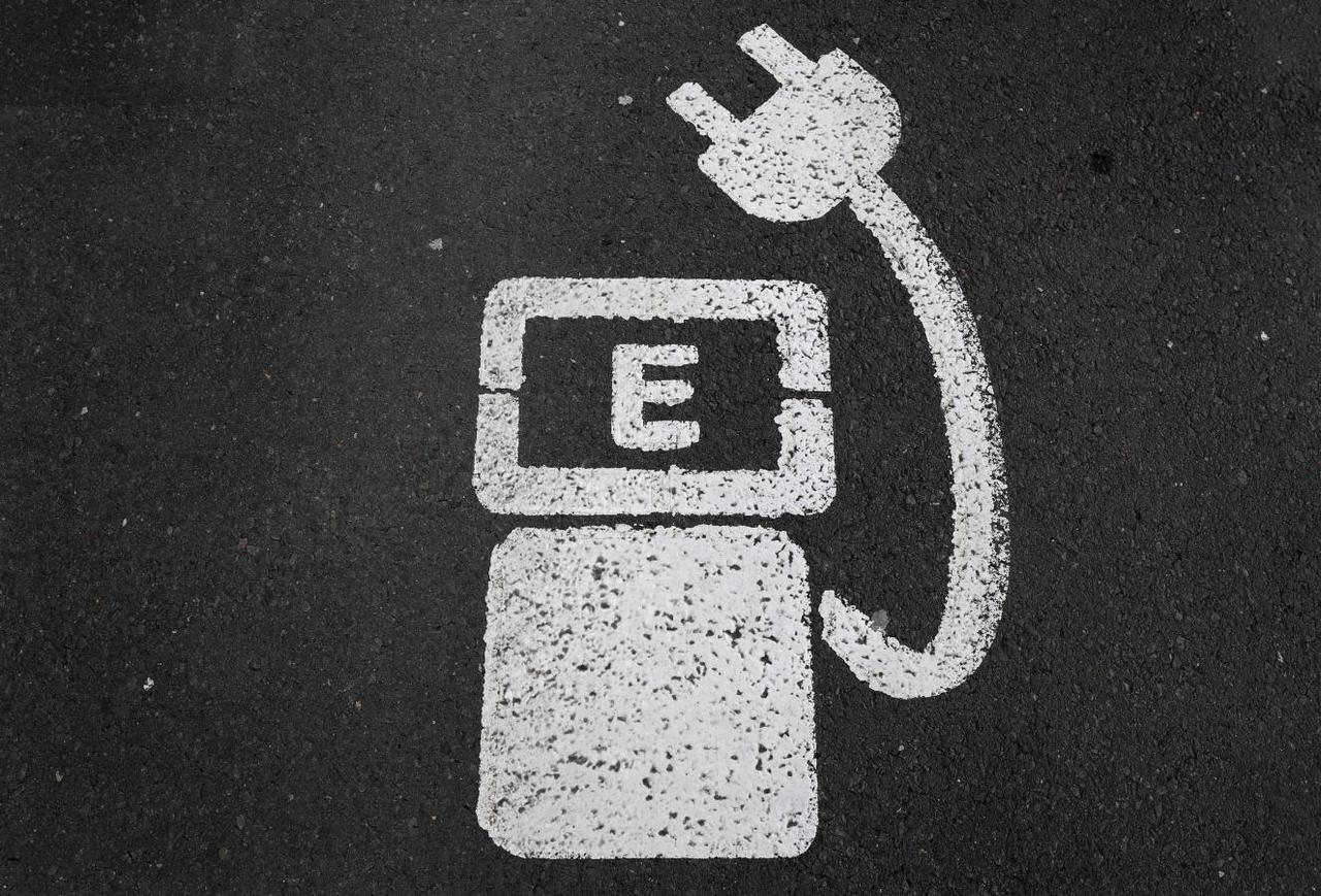 Exclusive Apple Explores Charging Stations For Electric Vehicles Out In The Stadium Battery Is Source Of Electricity Our File Photo A Charger Sign Cars Painted On Ground Parking Near Soccer Wolfsburg Germany