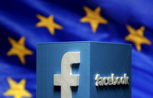 A 3D-printed Facebook logo is seen in front of the logo of the European Union in this picture illustration made in Zenica, Bosnia and Herzegovina on May 15, 2015.   REUTERS/Dado Ruvic