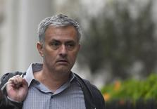 Former Chelsea manager Jose Mourinho walks towards his house in London, May 25, 2016. REUTERS/Toby Melville