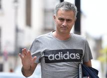 Jose Mourinho gestures as he walks towards his house in London, Britain, May 27, 2016. REUTERS/Toby Melville