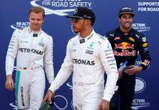 Formula One - Monaco Grand Prix - Monaco - 28/5/16. Red Bull Racing F1 driver Daniel Ricciardo (R) celebrates pole position with Mercedes drivers Nico Rosberg (L) and Lewis Hamilton.  REUTERS/Eric Gaillard - RTX2ELLO