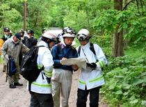 People search for a seven-year-old boy who went missing two days earlier, in Nanae town on the northernmost Japanese main island of Hokkaido, Japan, in this photo taken by May 30, 2016. Mandatory credit Kyodo/via REUTERS