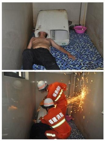5月29日、中国・福建省で、男性が洗濯機に頭を突っ込んで抜けなくなり、消防隊が出動する騒ぎがあった(2016年 ロイター)