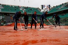 Tennis - French Open - Roland Garros - Courts crew sweep away water as rain falls at French Open - Paris, France - 31/05/16.    REUTERS/Pascal Rossignol