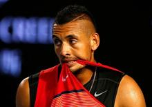 Australia's Nick Kyrgios bites his shirt during his third round match against Czech Republic's Tomas Berdych at the Australian Open tennis tournament at Melbourne Park, Australia, January 22, 2016. REUTERS/Thomas Peter/Files