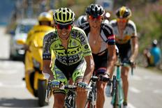 Tinkoff-Saxo rider Alberto Contador of Spain (L) and Giant-Alpecin rider Warren Barguil of France cycle during the 186.5-km (115.88 miles) 18th stage of the 102nd Tour de France cycling race from Gap to Saint-Jean-de-Maurienne in the French Alps mountains, France, July 23, 2015. REUTERS/Benoit Tessier