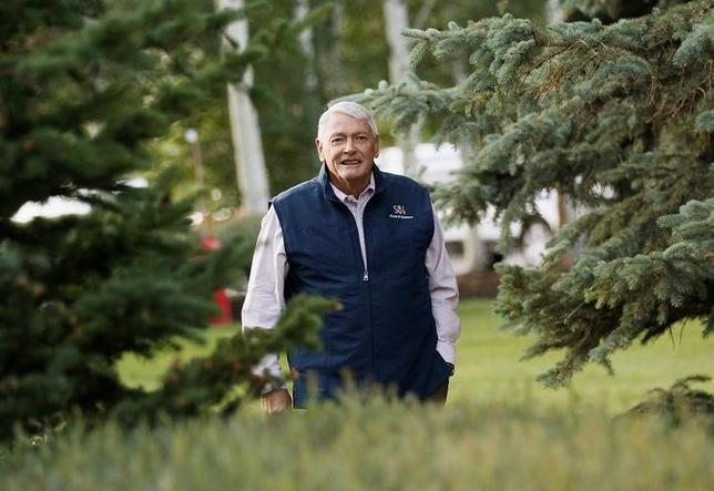 Liberty Media Corp. chairman John Malone arrives at the annual Allen and Co. conference at the Sun Valley, Idaho Resort July 12, 2013.  REUTERS/Rick Wilking/File Photo