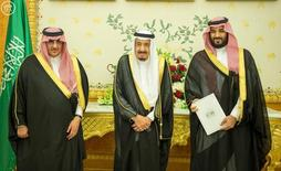 (L-R) Saudi Crown Prince Mohammed bin Nayef, Saudi King Salman, and Saudi Arabia's Deputy Crown Prince Mohammed bin Salman stand together as Saudi Arabia's cabinet agrees to implement a broad reform plan known as Vision 2030 in Riyadh, April 25, 2016. Saudi Press Agency/Handout/File Photo via REUTERS/Files